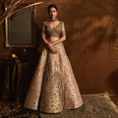 Walk down the aisle channelling an enriched elegance in this ensemble. Shop the look at Pernia's Pop-Up Shop. Golden Bridal Lehenga, Latest Bridal Lehenga, Designer Bridal Lehenga, Bridal Lehenga Choli, Indian Lehenga, Indian Bridal, Indian Wedding Outfits, Indian Outfits, Indian Clothes