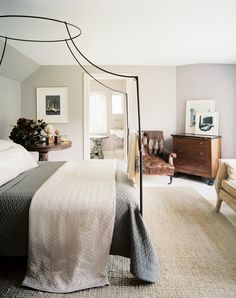 Great masculine and feminine elements that do not fight, but create a relaxing, classic bedroom.