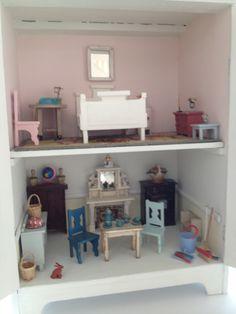 Cupboard dolls house