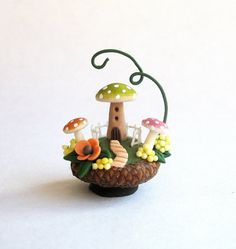This miniature fairy mushroom house in acorn cap is a one of a kind original design and creation by artist C. Rohal. It is completely hand made