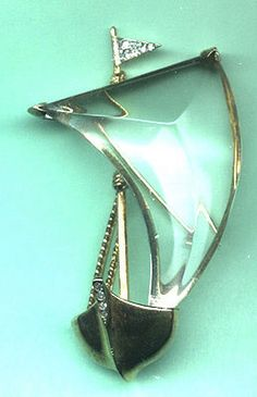 "TRIFARI 2-1/4"" sailboat brooch, a realistic boat with Lucite sail set in sterling/gold vermeil. Signed ""Trifari Sterling""."
