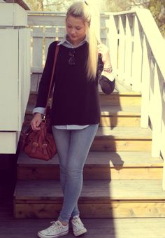 Black sweater over jean shirt, jeans, red bag and casual sneakers