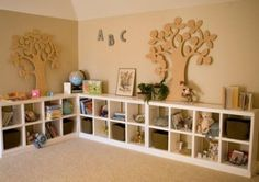 Kids Playroom Storage Ideas. LOVE this idea for the walls and corner of basement family room