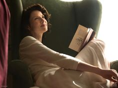 This official photo was just posted a couple of hours ago by Outlander on Starz. This photo features Claire (Caitriona Balfe) lounging in 1940s Iverness reading a book about plants. Source: Outlan…