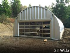 This quonset garage has a really cool windowed roll up door. Very cool indeed!