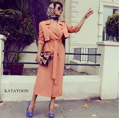 Persian Fasion_Iranian Woman_ This classic trench coat-dress in a warm peach tone by Katayoon London is lively with cobalt blue accessories. Iranian Women Fashion, Muslim Fashion, Modest Fashion, Hijab Fashion, Fashion Dresses, Trench Coat Dress, Beautiful Evening Gowns, Stylish Work Outfits, Elegant Outfit