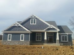 Certain Teed Pacific Blue vertical Siding and shakes. Craftsman ranch new home construction
