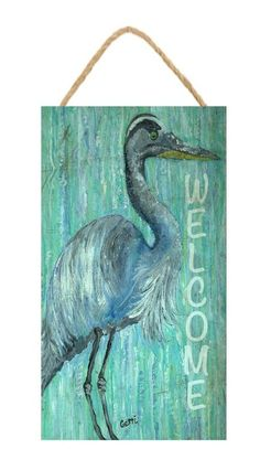 Welome  beach house sign created with a large blue heron on a pretty green and…