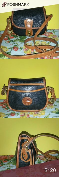DOONEY BOURKE*RARE*VTG 'ARROWHEAD SPORTING POUCH' Gorgeous Rare Dooney Bourke R113 small black pebbled leather bag with british tan accents. You prob won't see another like this, VERY RARE!!!! This adorable styled bag is in beautiful vintage condition. There are no scuffs or marks inside or out. This bag is 7.5in wide x 5.75in tall and 2.5in deep. There is a large slip pocket in back and one slip pocket inside. Great bag to wear crossbody for hands free! Strap is adjustable at 23in at its…