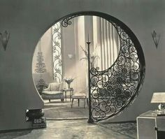 Art Deco iron entryway. It's like a swanky hobbit hole. I like it!