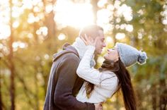 Beautiful young couple hugging and kissing. Sunny autumn nature.