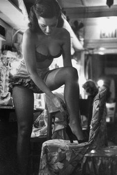 Showgirl Linda Lombard getting ready for a show. Photograph by George Silk. New York City, November 1949.