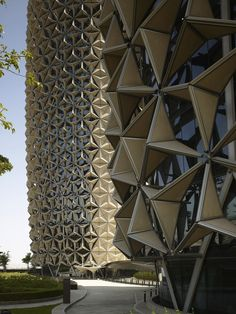 The Al Bahr Towers by Aedas, Wrapped in Solar-powered Mechanical Parasols. Full article on garakami.com