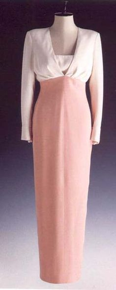 Catherine Walker designed this long dinner dress for the Princess of Wales in 1992. The dress has cream silk bodice and salmon-pink silk skirt. The original design had a low-cut V neck, but Diana thought it was too revealing so she asked for the insert to be sewn in. Diana wore it to the London Coliseum on July 7, 1992 for a performance of Coppelia by the Australian ballet. She also wore it on July 8, 1993 on a visit to Mudchute Park and Farm. Lot #71 raised $ 25,300 for Diana's charities.