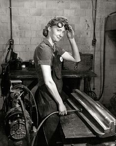 Woman worker -- What a great expression! Grinding a machined part at Curtiss-Wright plant, St. Louis, 1943-44. Photograph by F. Dale Smith, now in Missouri History Museum