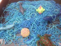 Under the Sea Theme Sensory Play: Dyed spaghetti & Toy Fish etc - Kids&Baby Toys Under The Sea Crafts, Under The Sea Theme, Under The Sea Party, Reggio Emilia, Eyfs Activities, Nursery Activities, Pirate Activities, Indoor Activities, Family Activities