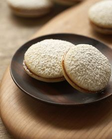 A recipe for alfajores, a type of cookie filled with dulce de leche (caramel) found in parts of Spain and Latin America Köstliche Desserts, Delicious Desserts, Dessert Recipes, Yummy Food, Macarons, Caramel, Great Recipes, Favorite Recipes, Martha Stewart Recipes
