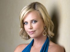 DO: Charlize Theron looks lovely in a cool blue dress. https://budtoblossombeauty.wordpress.com/light-cool/