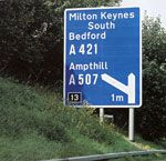 British Motorway signs. When you're motoring on the wrong side of the road, you need all the help you can get.