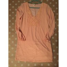 Long sleeve peach dress with crochet detail This dress is a gorgeous peach color that would be perfect for spring, and with its on trend crochet detailing its a great addition to anyone's closest! Dresses Long Sleeve