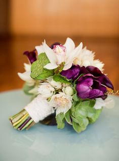 a twist of a classic - whites, plums & green wedding bouquet using tulips, cymbidium orchids, blushing bride, lotus pods, helleborus...yes please