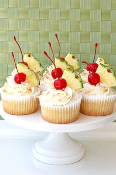 Pina Colada Cupcakes with Coconut Cream Cheese Frosting    Pineapple Cupcakes  (recipe by Glorious Treats)    2 1/2 cups flour  1 1/2 teaspoons baking powder  1/2 teaspoon baking soda  1/2 teaspoon salt  3 eggs  1 3/4 cups sugar  1 cup vegetable oil  1 teaspoon vanilla extract  3/4 cup sour cream  1 1/2 cups canned crushed pineapple (drained slight