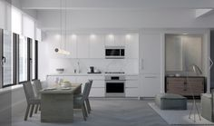 --look at the alcove with grey wall and painting. -- A full-height stone backsplash and integrated refrigerator enhance the kitchen's simple elegance Tidy Kitchen, Kitchen And Bath, New Kitchen, Buying A Condo, Stone Backsplash, Minimalist Kitchen, Pent House, Grey Walls, Cool Kitchens