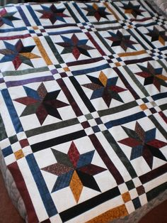 I like this pattern and colors for a barn quilt