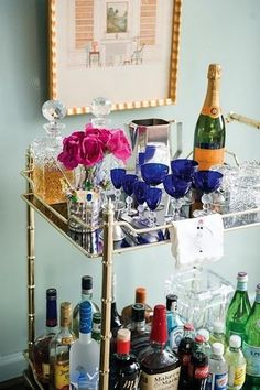 If you can't afford to add a bar to your space, try a bar cart like this one.