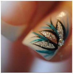 French Tip Nail w/ a Blue, black, and silver flower design