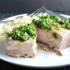 A zesty cilantro pesto tops pork chops roasted just right for an easy and tasty meal.