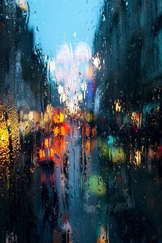 I like this picture because the design is rain, but it also comes off as a very artistic.  The colors give off a somber feel, and the bright lights of the cars create great contrast