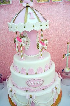 Pink and gold cake at a carousel birthday party! See more party ideas at CatchMyParty.com!