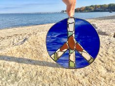 Sea Glass Peace Sign stained glass by BeachGirlGlassworks on Etsy https://www.etsy.com/listing/473181332/sea-glass-peace-sign-stained-glass