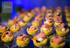 Freshly Baked Scallion Sweet Corn Cake served with Smoked Salmon and Citrus Creme Fraiche, topped with Salmon Caviar. [Thomas Beaman Photograph]
