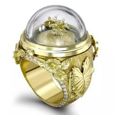 A design for which Theo Fennell has become famous, the Tropical Paradise Opening ring in yellow gold is decorated with hand-engraved flowers and diamonds (£POA).