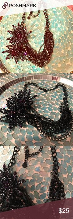 "Chunky and Fabulous Black/Purple Necklace Such a cool piece but WOW was it hard to capture its true beauty! Black&deep purple tones, varying strands of crystals & chains that are supposed to be a little twisted and crazy! Two medium sized ""flowers"" sit on the side & are the focal point. I lightened the last photo to get the flowers to translate to how they look in real life. You can really see the deep purple tones in real life. Measures 9 1/2"" long, sits on the collarbone, 3"" adjustable…"