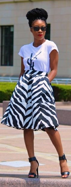 #officewear #streetstyle | a white tee paired with a zebra print flared midi skirt and ankle strap sandal
