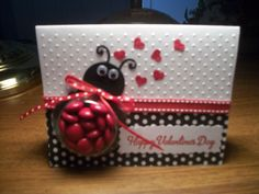 ladybug treat cup card filled with red m's.