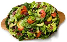 Green salad gets some Cuban flair with the addition of avocados, tomatoes, and black beans.