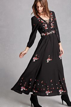 A woven maxi dress by RD and Koko™ featuring a floral embroidery, a surplice neckline with a lace-up front, long sleeves with elasticized cuffs, shirred waistline, and an invisible side zipper.
