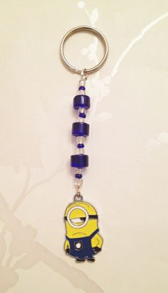 Handmade Key Rings £2.50. A gift idea by BraceletsEtc by Wendy found on MyOwnCreation.co.uk: Minion keyring charm with a mix of blue beads and silver lined seed beads.  Approx 9.5cm from top of beads to end of Minion charm.
