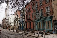 An old fashioned street with paving stones and fire escapes, but smokestacks in the distance.