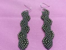 Macrame earings made by waxed cord and beads. I used silver hooks.