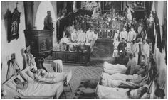 Soldiers attend Mass in a French Church During World War 1. The Front of the Church has been converted into a makeshift hospital and several wounded soldiers are lying on the ground.