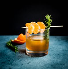 Tangerine, honey, and rosemary old fashioned cocktail recipe.