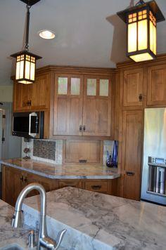 Craftsman kitchen, moon night granite, Arroyo Craftsman pendant lights, GE Monogram appliances, Moen faucets