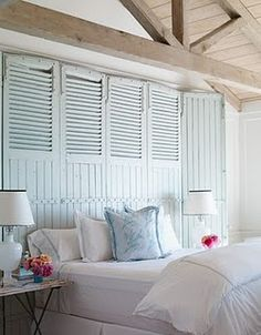 Shutter headboard for an easy beach cottage bedroom style.