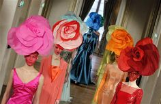 At his Paris haute couture show, Alexis Mabille created floral fantasy headpieces in a rainbow of brights.