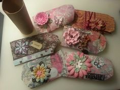 Save up your used toilet paper rolls to make unique personalized giftcard holders! I used scrapbook paper with matching embellishments. Cut you paper 2-3 inches longer than the roll. Glue in a couple cm to cover the roll and then glue shut the bottom half. Once you've flattened the tube, squeeze the sides to make it pop out a bit. Perfect size for gift cards! After the card or money etc. goes in, flip the open sides in! :-) I did these in under an hour at no cost, because I had everything I…